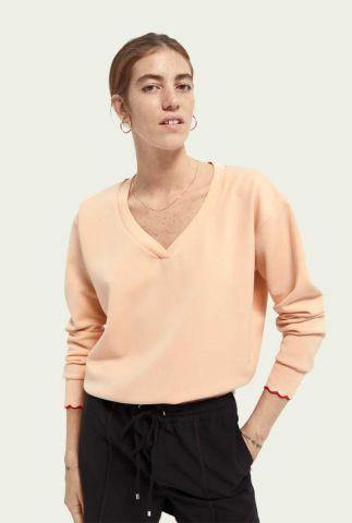 licht perzik kleurige sweater met v-hals 161687