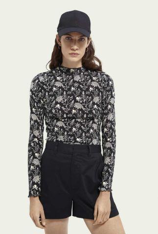 zwarte top met witte bloem print en ruffle kraag 161691