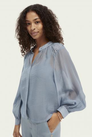 lichtblauwe semi-transparante blouse met pofmouwen 162489